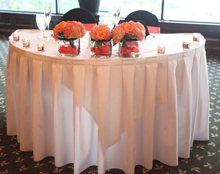 Half-moon sweetheart table wedding decor