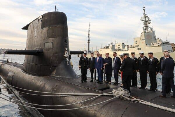 President Emmanuel Macron of France, second from left, and Malcolm Turnbull, then prime minister of Australia, third from left, on an Australian submarine during a 2018 visit by Mr. Macron to Sydney.