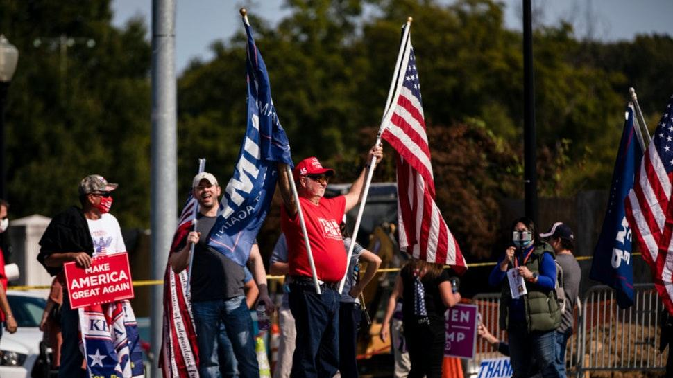 Supporters of President Donald Trump gather outside of Walter Reed National Military Medical Center after the President was admitted for treatment of COVID-19 on October 4, 2020 in Bethesda, Maryland.