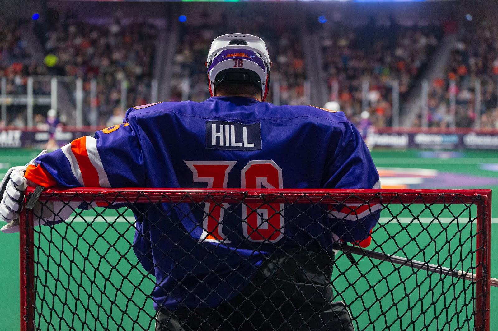Pro lacrosse goalie From behind looking down the floor