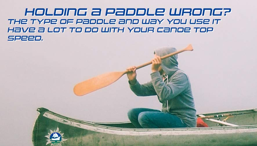A young lad holds a paddle wrong in this image.  He will never get much speed if holding the paddle the wrong way.