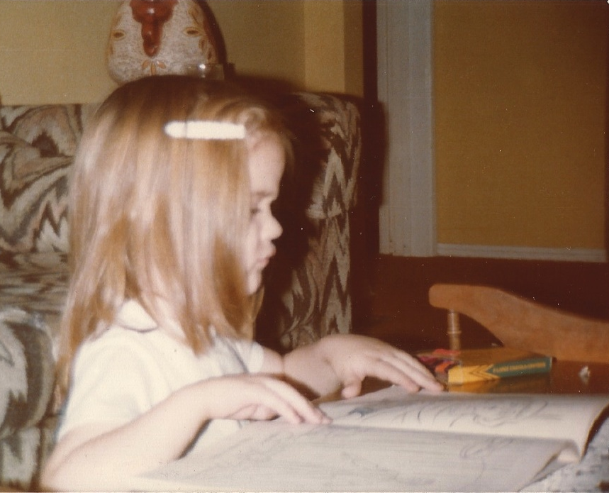 Photograph of poet kathryn l. pringle as a child kneeling before a book