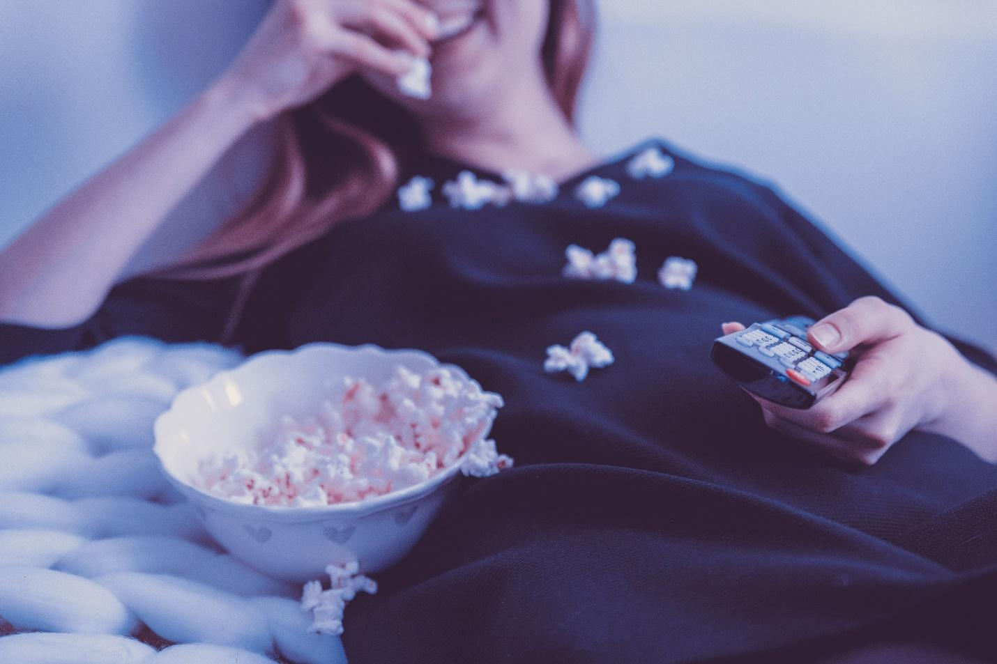 Binge watching tv with snacks; be sure to not watch too much tv and overdo it
