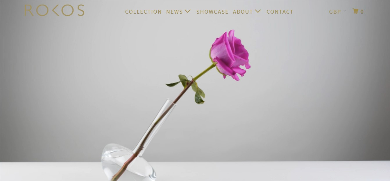 Rokos' landing page - a purple rose on a gray background