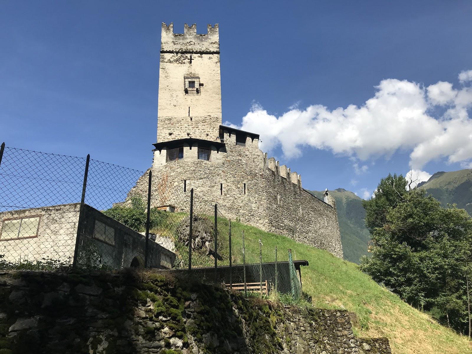 Climbing Passo del Mortirolo from Mazzo di Valtellina, castle