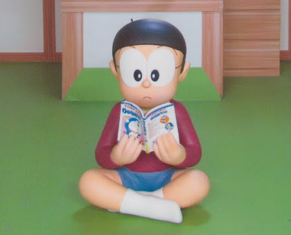 Nobita reading a Doraemon comic, from the 100 Years Doraemon Exhibit in Kuala Lumpur