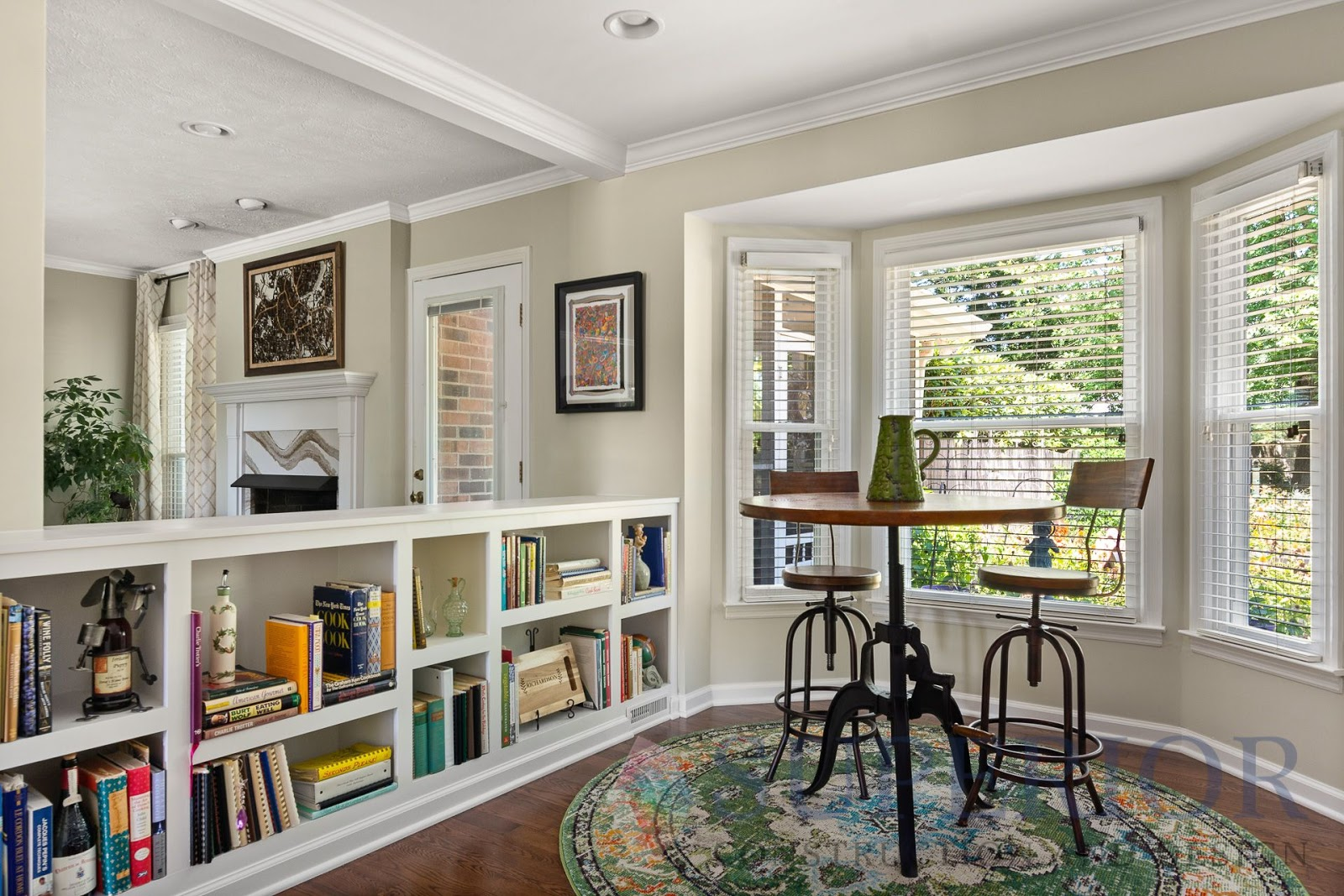 superior construction and design create a multi-functional space built in bookshelf and breakfast nook with high top table
