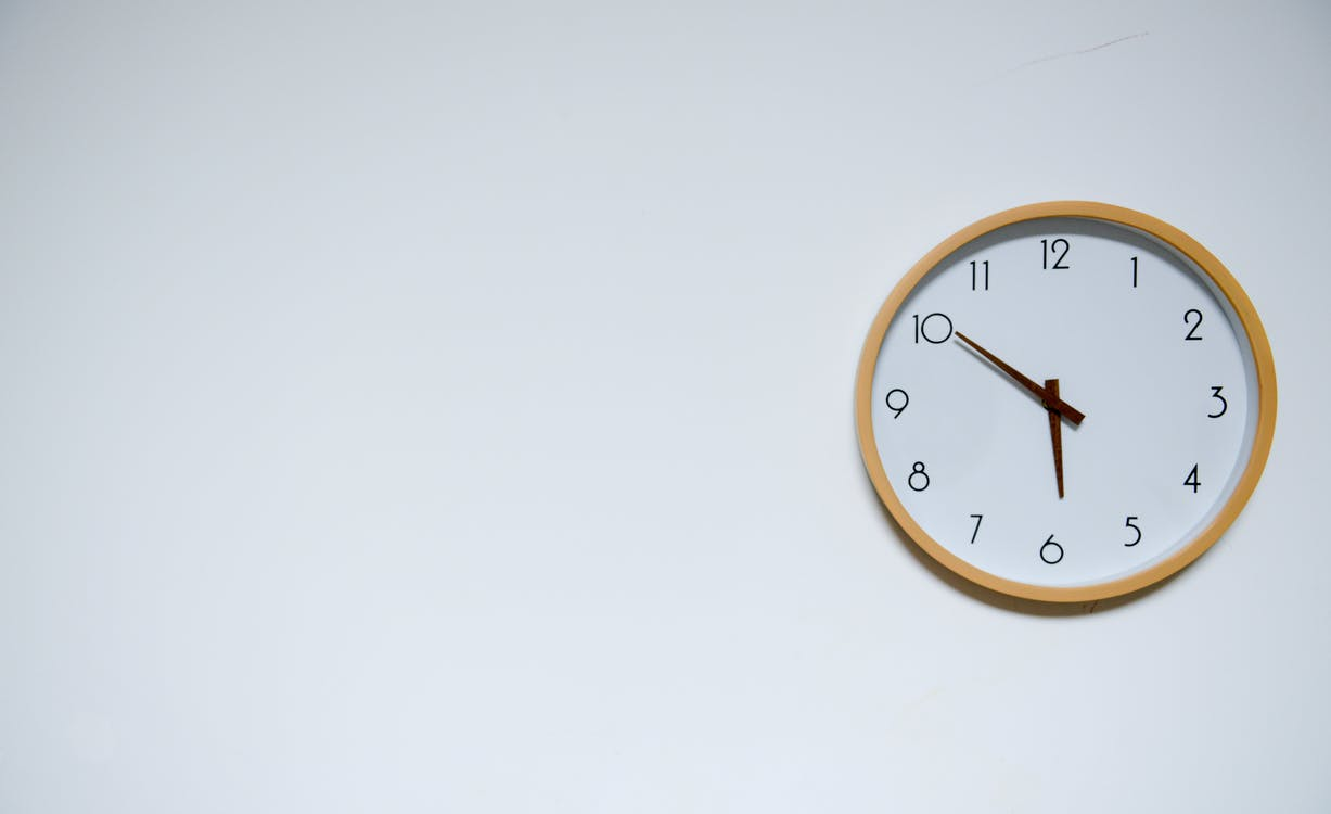 Wall Clock on white background at 5:50