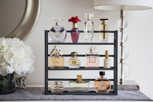 An upcycled spice rack works great for displaying & organizing perfume bottles!
