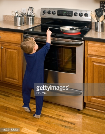 hot-stove-danger-toddler-reaching-picture-id157315583