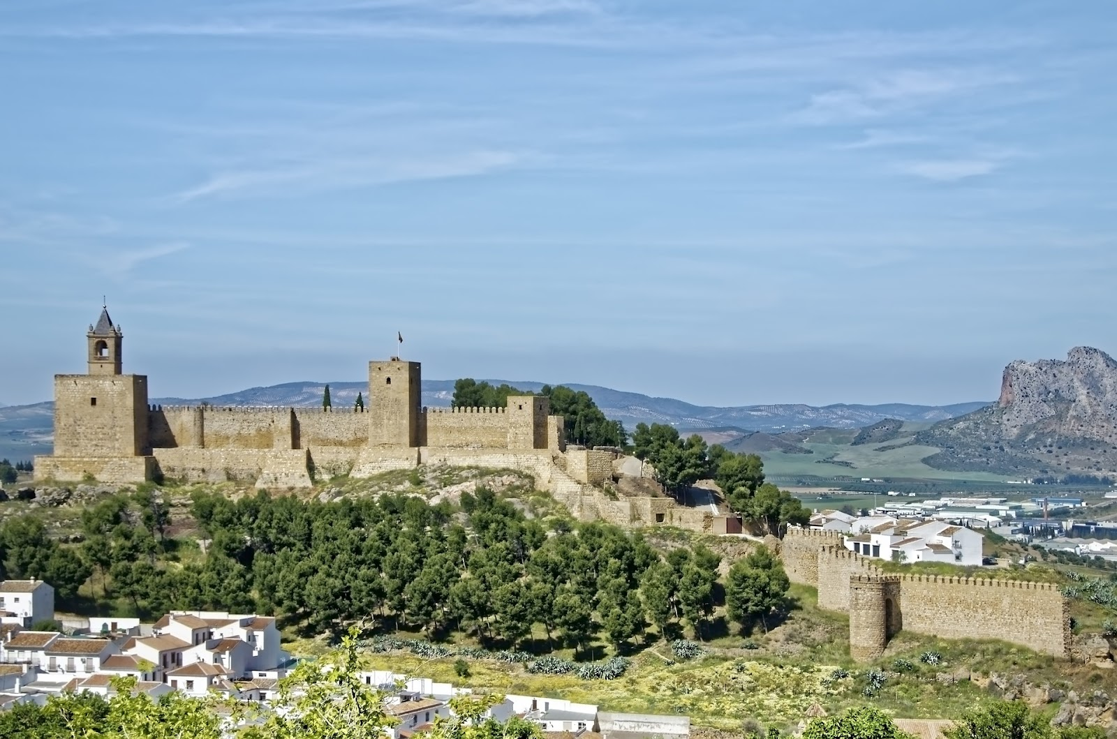 antequera alcazaba fortress castle fields in background spain