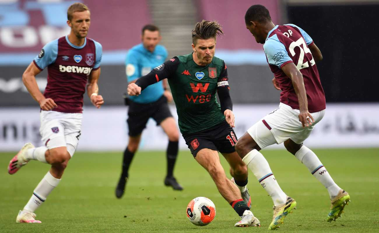 Issa Diop of West Ham goes in to tackle Aston Villa's Jack Grealish - Photo by Andy Rain/Pool via Getty Images