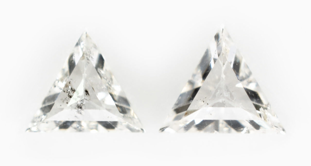A matched pair of triangles with visible inclusions