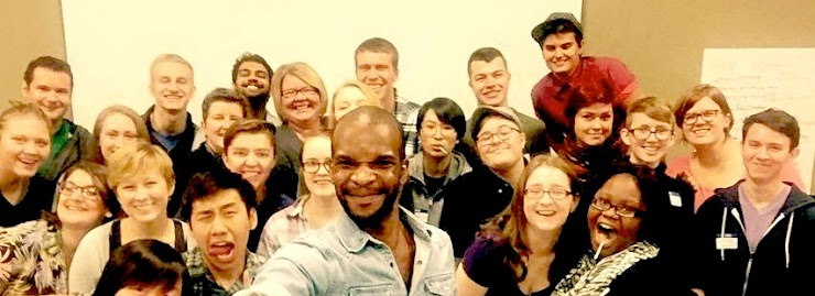 Image of 2015 leadership retreat cohort showing a diverse crew of queer and trans folks smiling for the photo