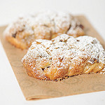 close-up photo of a pastry dusted with powdered sugar