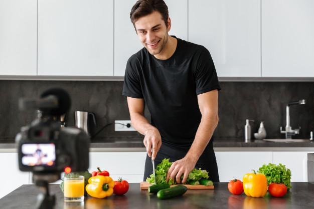 A person cutting vegetables in a kitchen  Description automatically generated with medium confidence