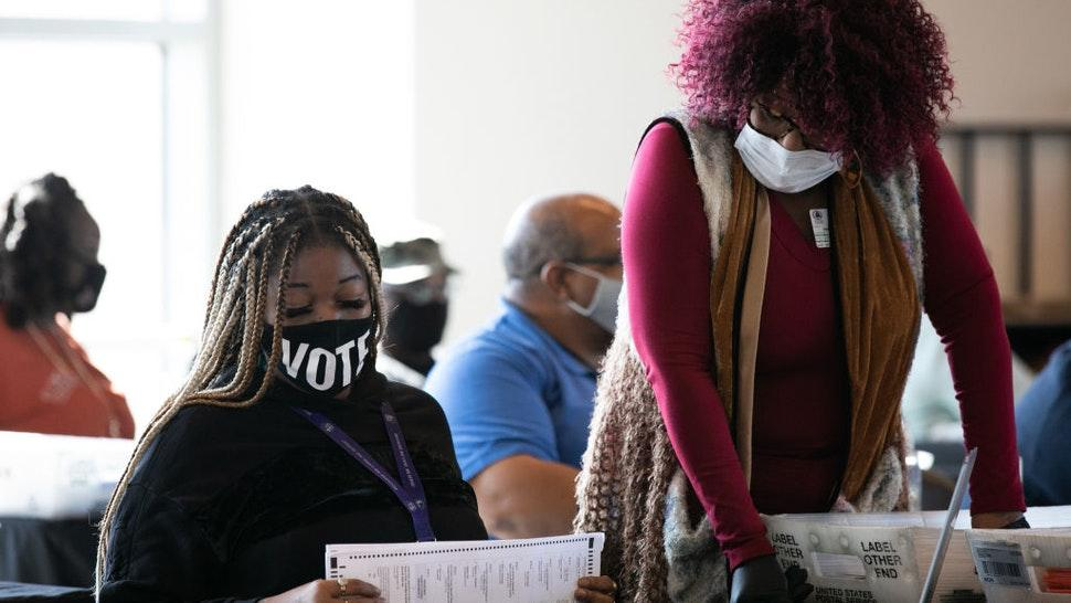 Fulton county workers continue to count absentee ballots at State Farm Arena on November 6, 2020 in Atlanta, Georgia.