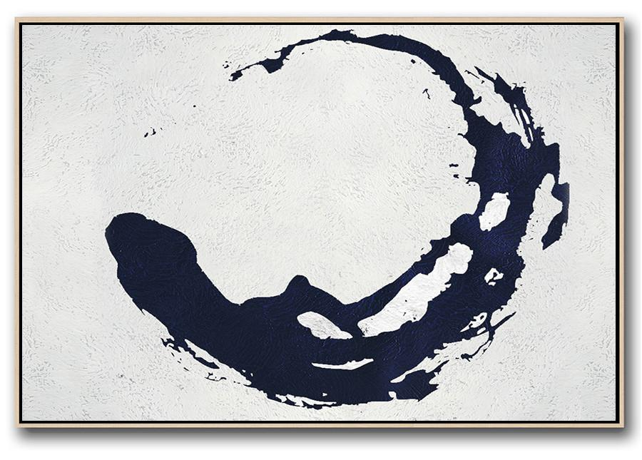 This art piece is a minimalist style, on a blank canvas with what appears to be a swirl of navy blue.