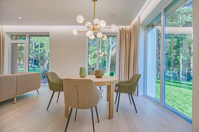 a dining area with light flooring