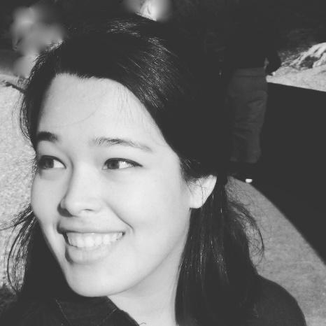A black and white photo of a woman smiling (Chelsea Lim) Description automatically generated