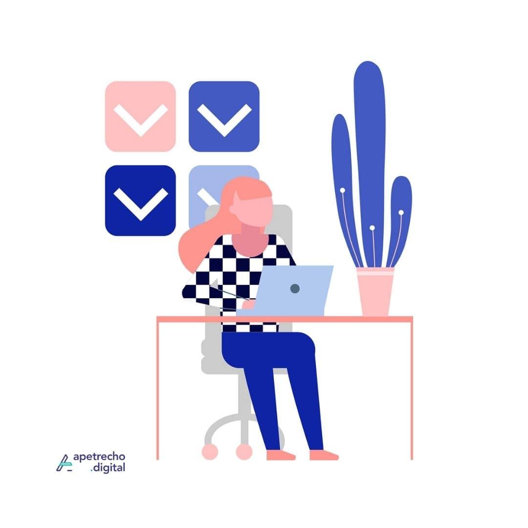 Menina sentada em uma cadeira com uma mesa com computador a frente mostrando ser organizada