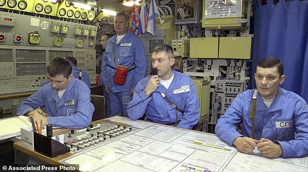 Russian Karelia nuclear submarine's crew work during manoeuvres on Wednesday 9 which included the launch of a ballistic missile from the Karelia nuclear submarine in the Barents Sea, Russia