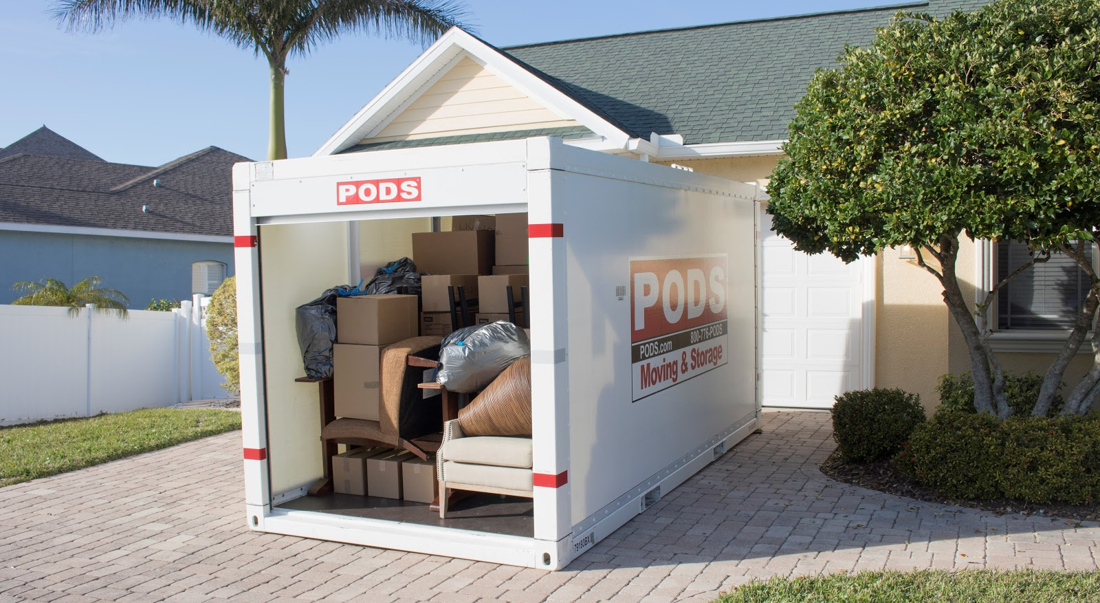PODS portable storage container loaded in a driveway