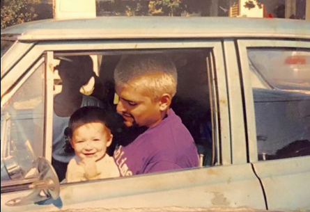 Bradley Nowell in the driver seat with his young child.