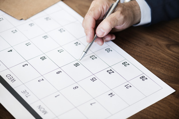 businessman marking calendar appointment