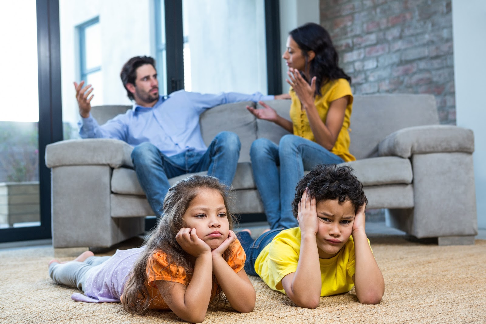 Children looking stressed while parents argue