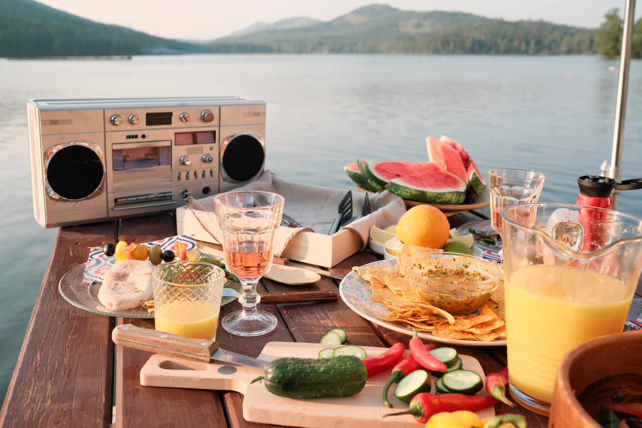 Boom box on table with food by the lake