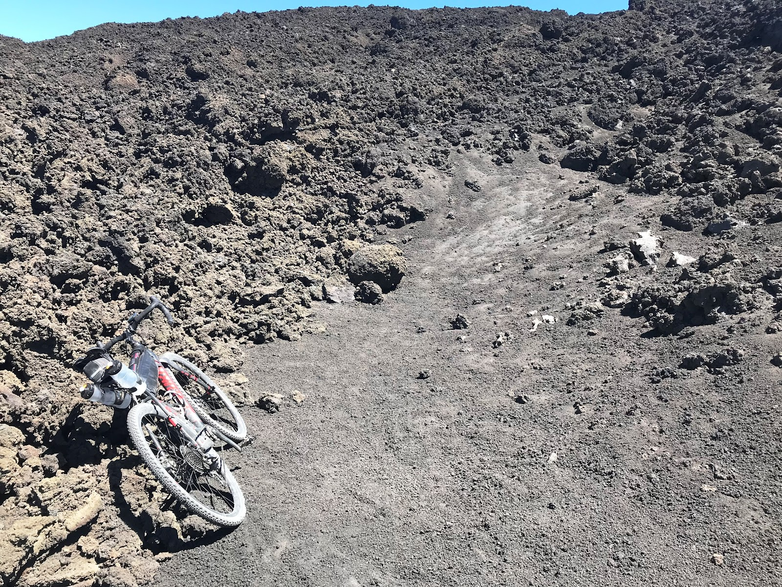 Mountain bike at end of Mount Etna cycling climb