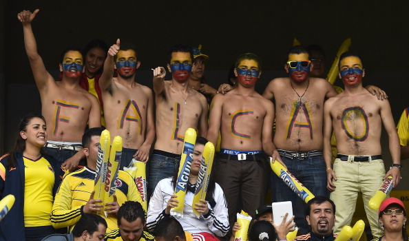 Fans of the Colombian national football team show their support to striker Radamel Falcao Garcia, who is recovering from surgery on ruptured cruciate ligaments, during the farewell to the squad at the Campin stadium in Bogota, on May 23, 2014. The team is heading to Argentina to play friendly matches against Senegal and Jordan as part of their preparation for the upcoming FIFA World Cup Brazil 2014 tournament.  AFP PHOTO/Luis Acosta        (Photo credit should read LUIS ACOSTA/AFP/Getty Images)