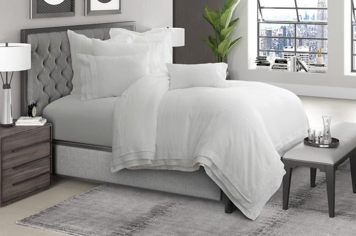 A bed with white sheets  Description automatically generated with low confidence