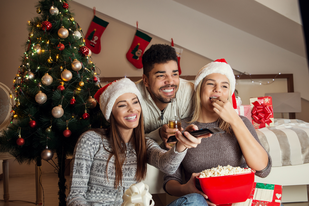 a family watching a movie in a holiday setting