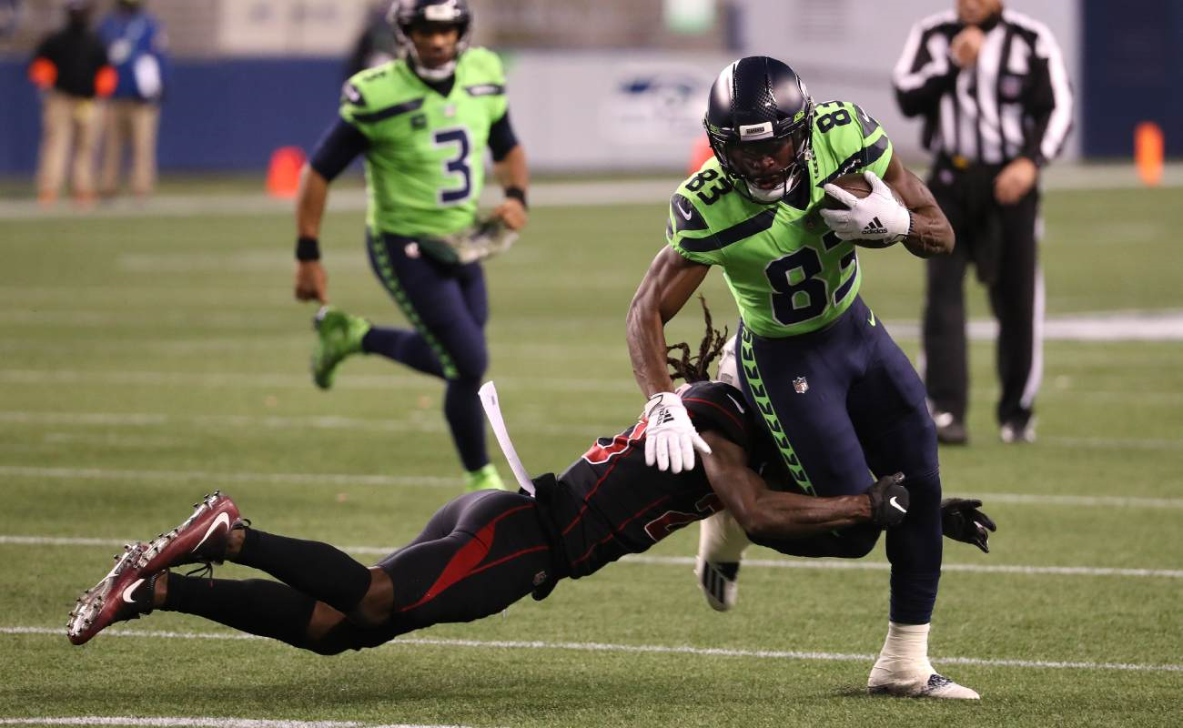 David Moore of the Seattle Seahawks gets tackled by a member of the Arizona Cardinals.