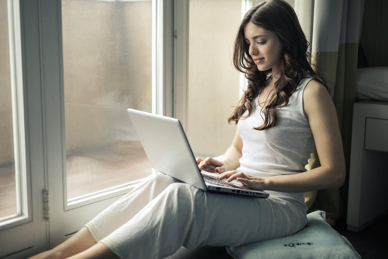 Woman reading at Freeport apartment   Latitude at Hammock Bay
