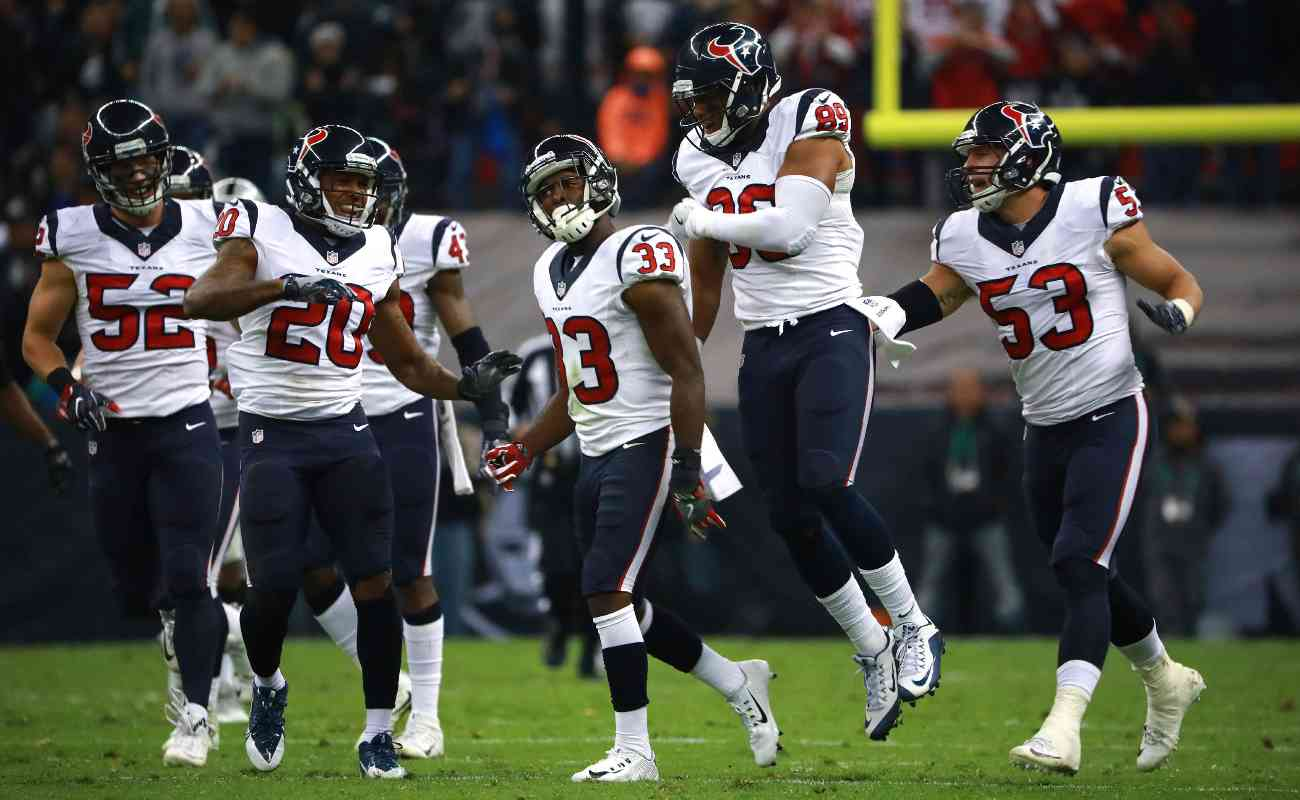 Houston Texans players celebrate in their game against Oakland Raiders.