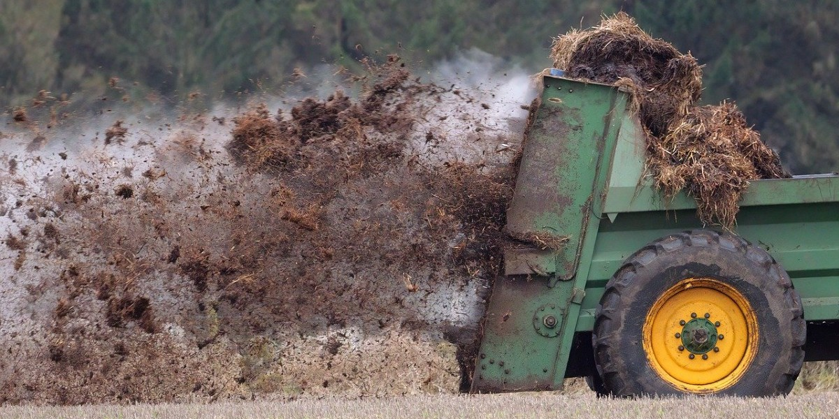 manure spreading on a wheat field
