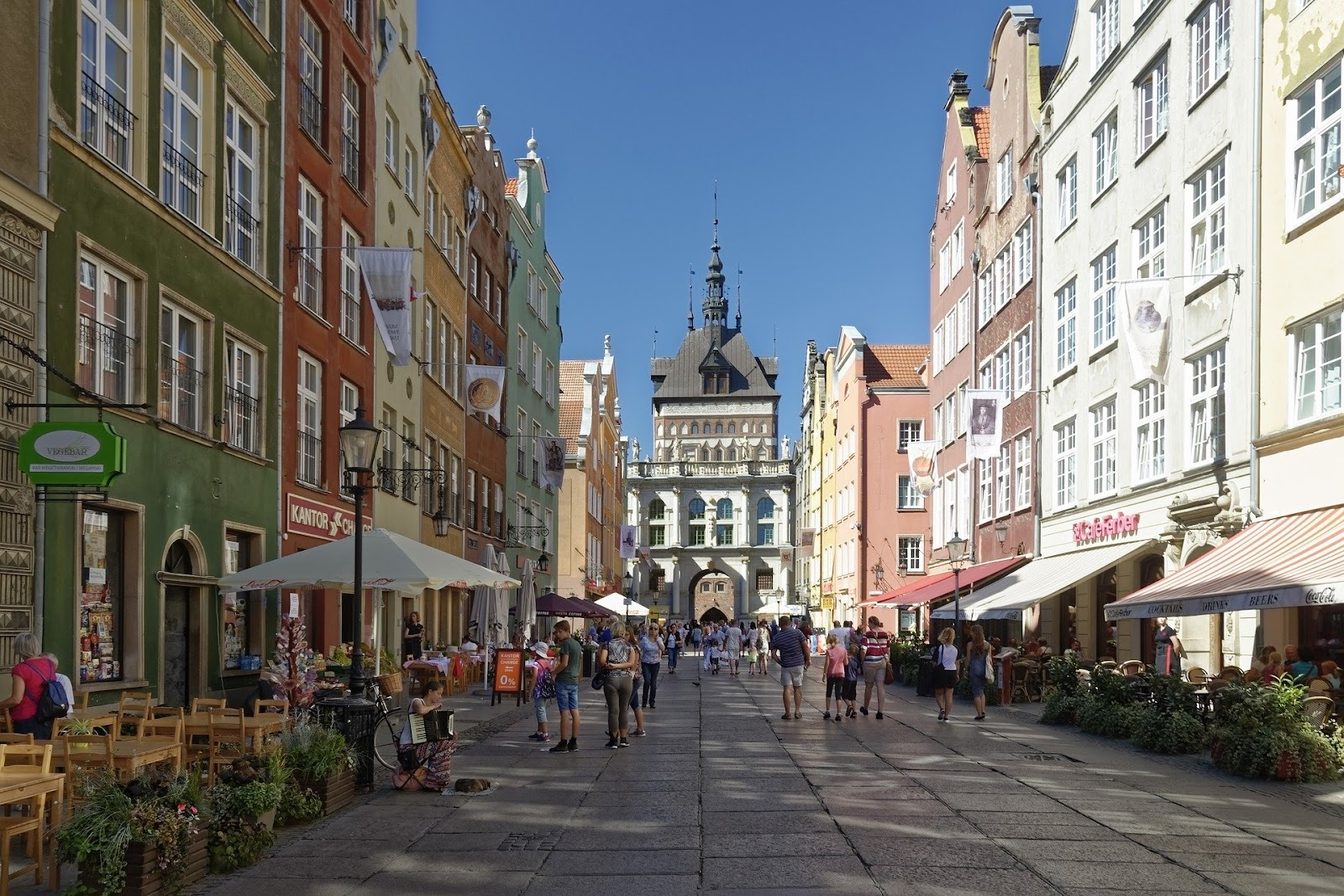 gdansk old town in summer colorful medieval buildings cobblestone road people restaurants poland