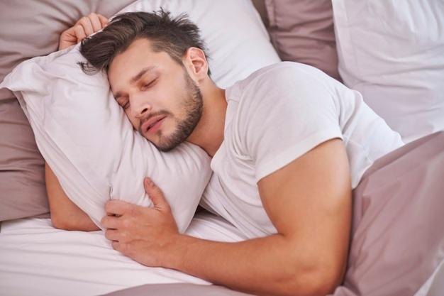 Exhausted man sleeping in his bed increase sperm volume
