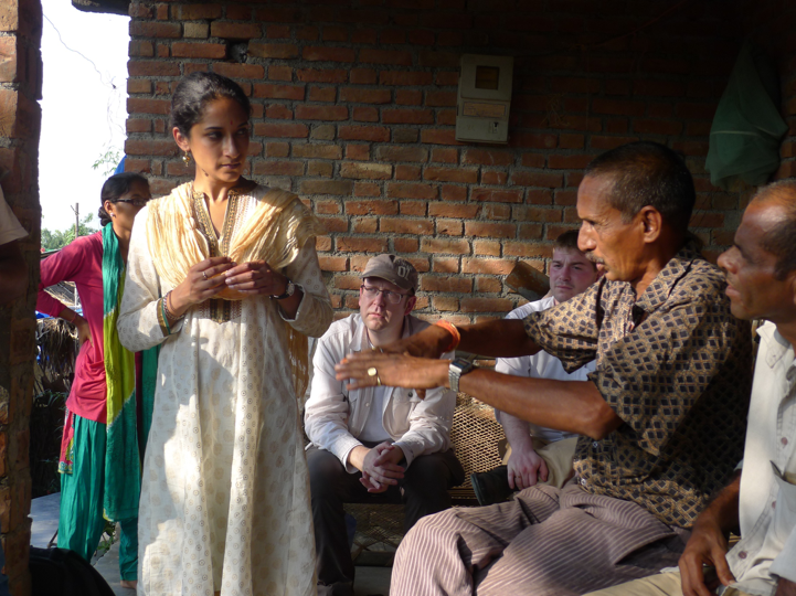 A conversation in Nepal between local residents and the Arsenic Biosensor team, discussing requirements for designing an arsenic biosensor. Credit: Jim Ajioka.
