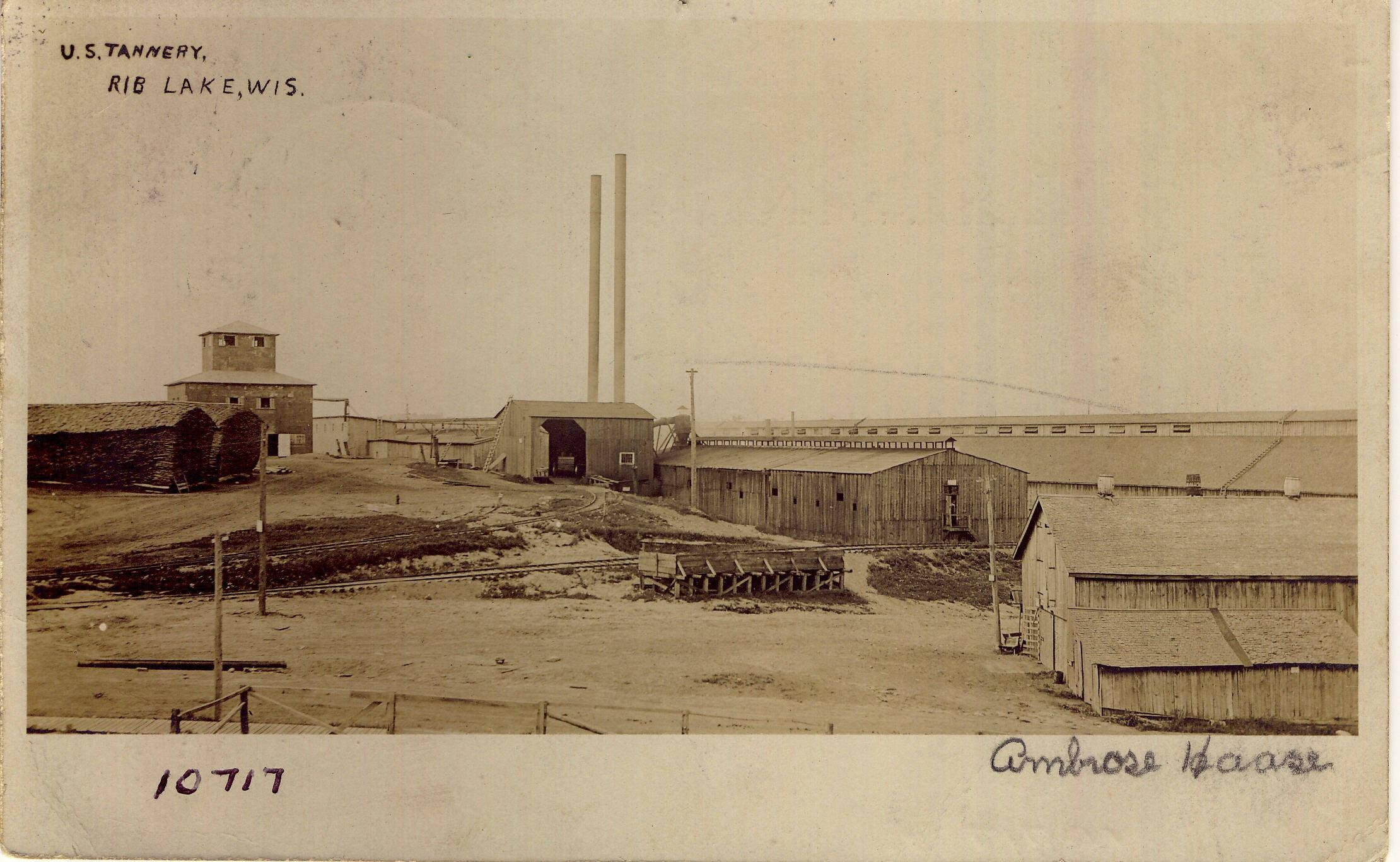 "C:\Users\Robert P. Rusch\Desktop\II. RLHSoc\Documents & Photos-Scanned\Rib Lake History 10700-10799\10717-P. ""U.S. Tannery, Rib Lake, Wis"" View from south c. 19.jpg"