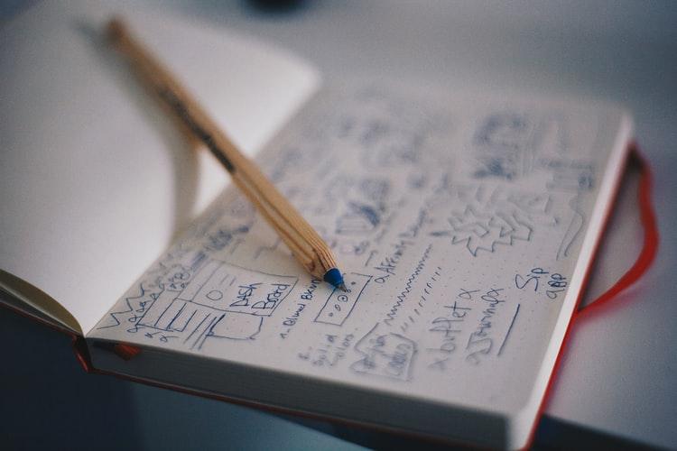 pen on top of drawn customer journey planner