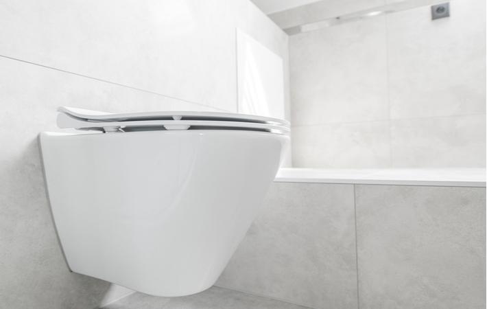 A white wall mounted toilet