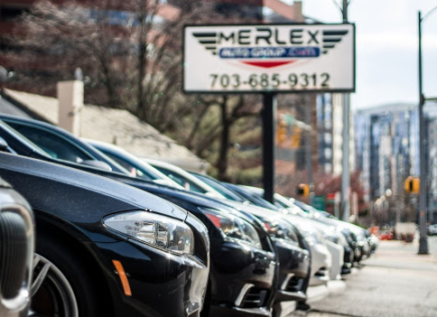Photo of cars lined up in front of Merlex Auto Group sign