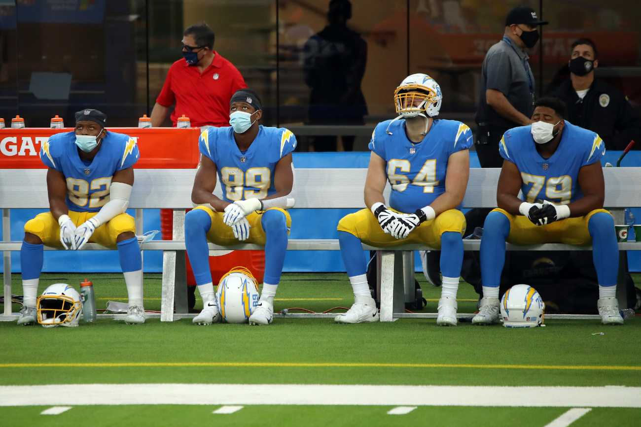 INGLEWOOD, CALIFORNIA - DECEMBER 06: Stephen Anderson #82, Donald Parham #89, Cole Toner #64 and Trey Pipkins #79 of the Los Angeles Chargers look on from the sideline during the second half against the New England Patriots at SoFi Stadium on December 06, 2020 in Inglewood, California. (Photo by Katelyn Mulcahy/Getty Images)