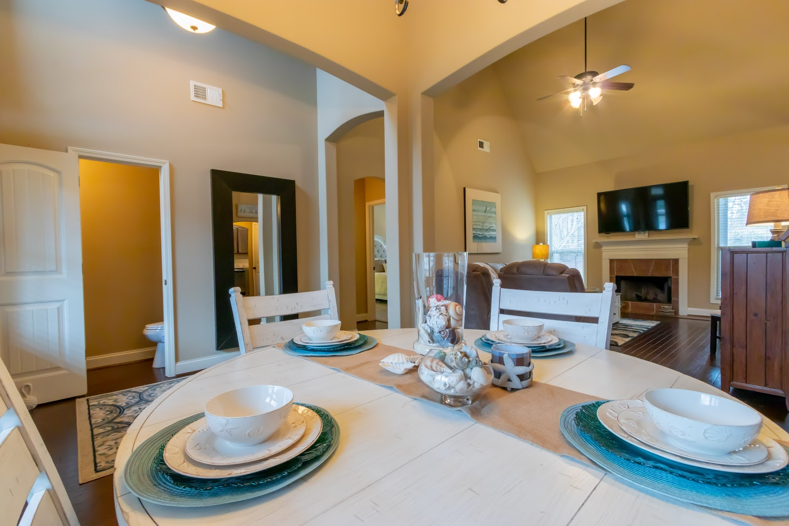 Add some pops of color to your dining room table with colorful chargers when staging your home