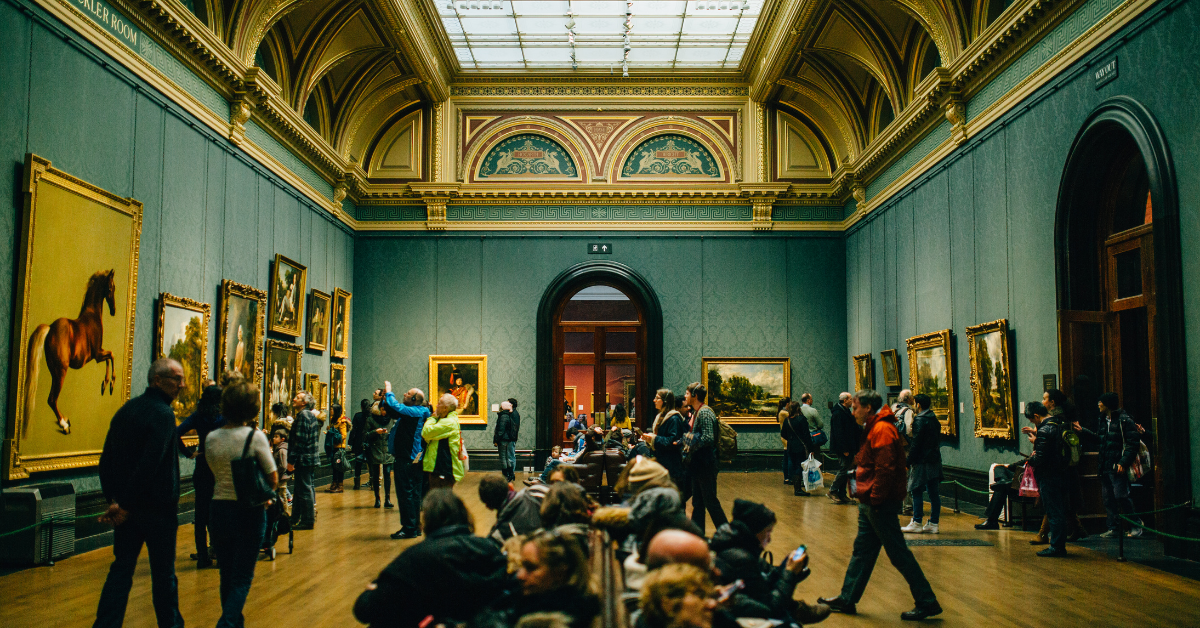 A crowd of people viewing art inside the Sackler Room at the British Museum