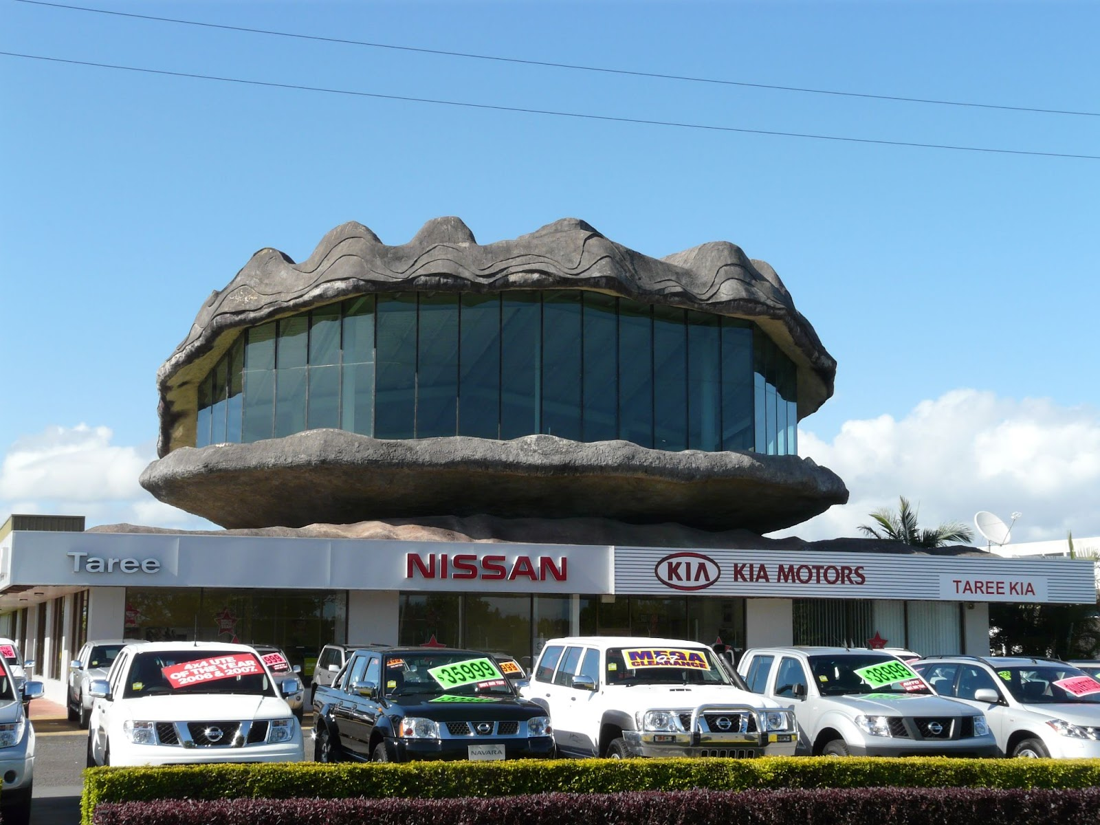 the big oyster sits on top of a nissan garage